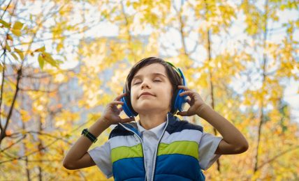 Boy listening in headphones