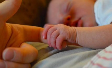 Baby Holding Parent Finger
