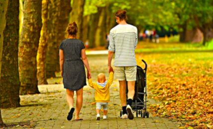 Child with Couple